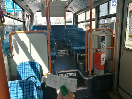 Inside a bus in Japan - public transportation is usually the cheaper option to get around while on a trip