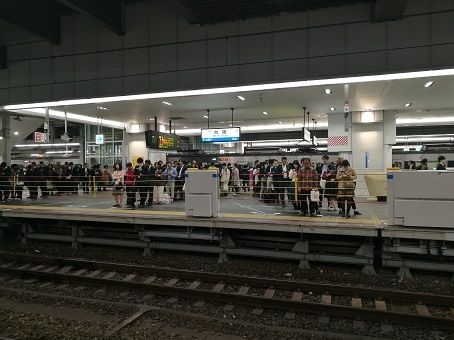 People queue waiting for a train in japan